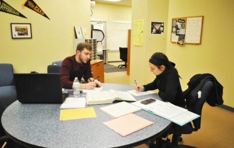 Sophomore Joe Lasser tutors sophomore Caitlyn Palazzi on March 28 in Owen Library's Academic Success Center.
