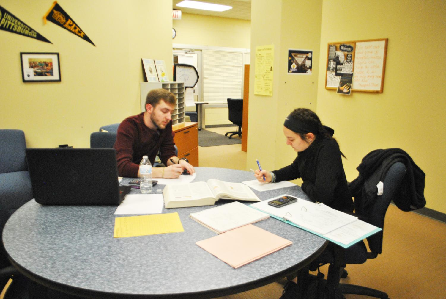 Sophomore Joe Lasser tutors sophomore Caitlyn Palazzi on March 28 in Owen Library's Academic Success Center.