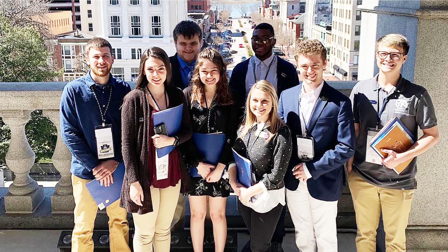 Several Pitt-Johnstown students, staff members and alumni toured the Pennsylvania State Capital building March 26 as part of the annual Pitt Day in Harrisburg event. Pictured: student government members stand on a balcony outside of Lt. Gov. John Fetterman's office.