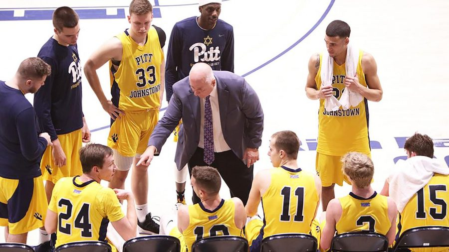 Men%E2%80%99s+basketball+head+coach+Bob+Rukavina+%28middle%29+coaches+the+Mountain+Cats+in+a+playoff+game+against+Gannon+University+March+4+at+the+Sports+Center.+Pitt-Johsntown+won+the+game%2C+70-60.
