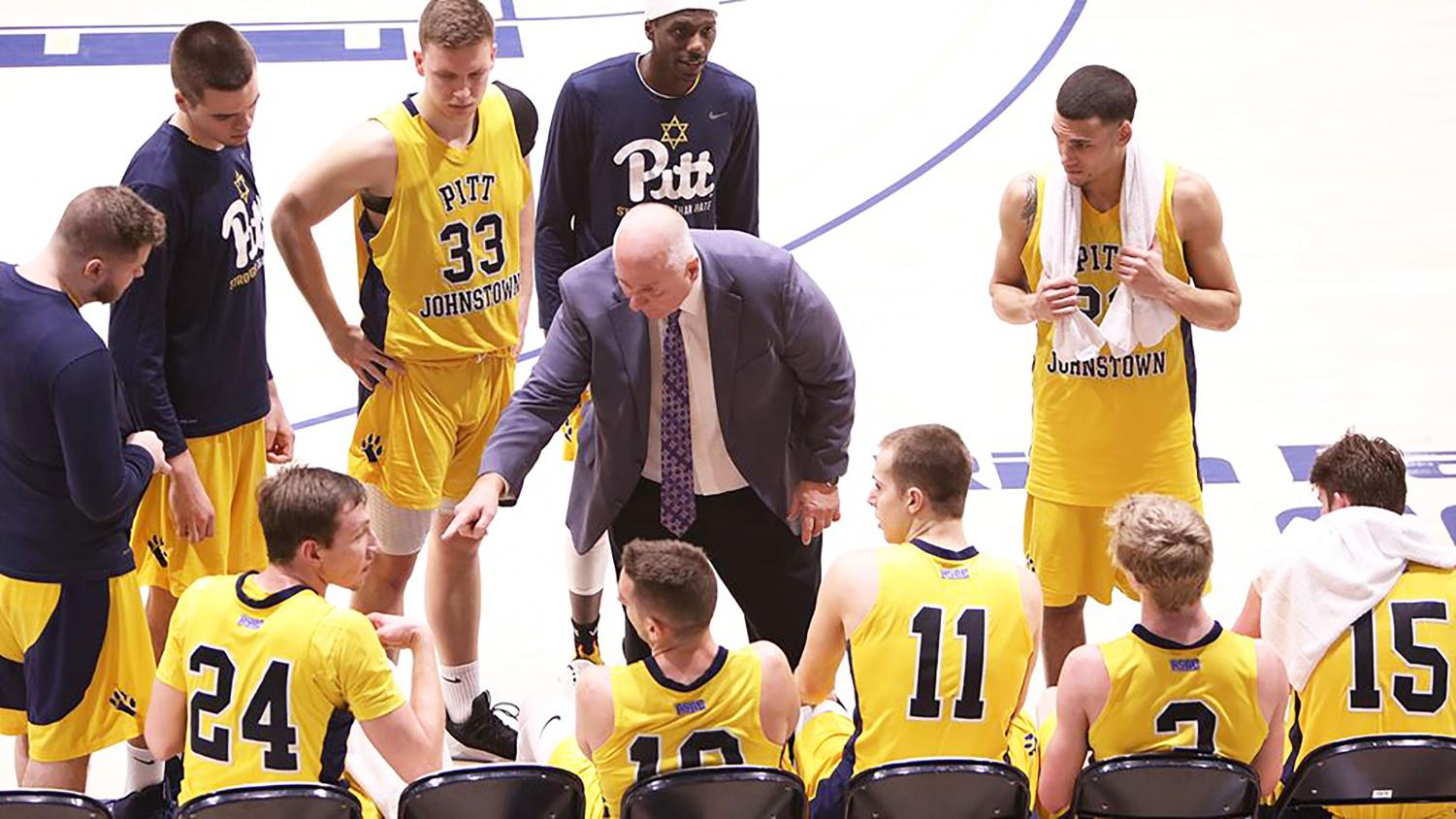 Men's basketball head coach Bob Rukavina (middle) coaches the Mountain Cats in a playoff game against Gannon University March 4 at the Sports Center. Pitt-Johsntown won the game, 70-60.
