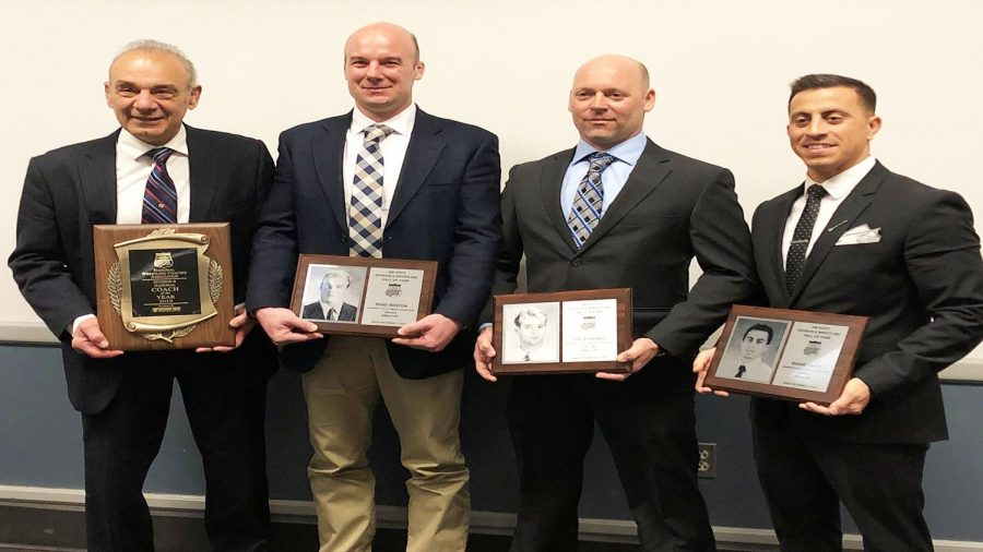 Mountain Cat head wrestling coach Pat Pecora (left) was named coach-of-the-year March 7 in Cleveland.