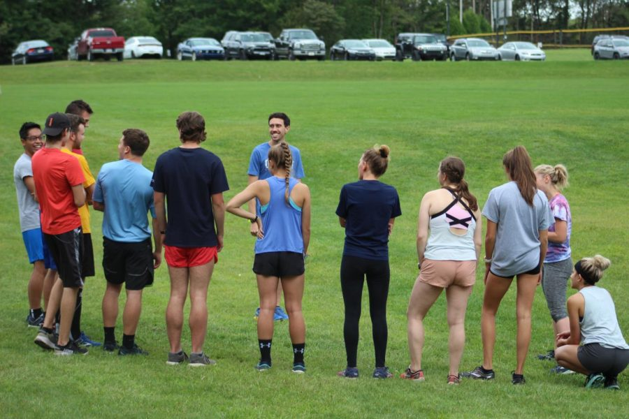 Pitt-Johnstown's cross-country coach Nick Rameriz held a short meeting before team training at the Pitt-Johnstown outdoor track Sept. 4.