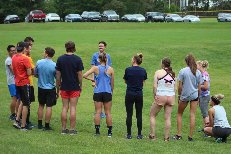 Pitt-Johnstown's cross-country coach Nick Rameriz held a short meeting before team training at the Pitt-Johnstown outdoor track Sept. 4.