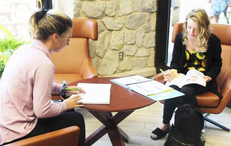 Freshmen Autumn Bozic (left) and Christina Morris (right) study in the Blackington Hall lobby Friday.  According to Pitt-Johnstown president Jem Spectar, new student enrollment has had a significant decline in the last few years.