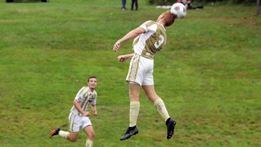 Pitt-Johnstown's Brady Brown headbutts the ball during a Sept. 24 game against Washington Adventist University at the Pitt-Johnstown soccer field; Pitt-Johnstown lost the game 1-2.