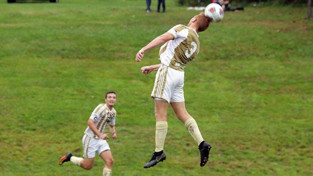 Pitt-Johnstown's Brady Brown headbutts the ball during a Sept. 24 game against Washington Adventist University at the Pitt-Johnstown soccer field; Pitt-Johnstown lost the game 1-2.