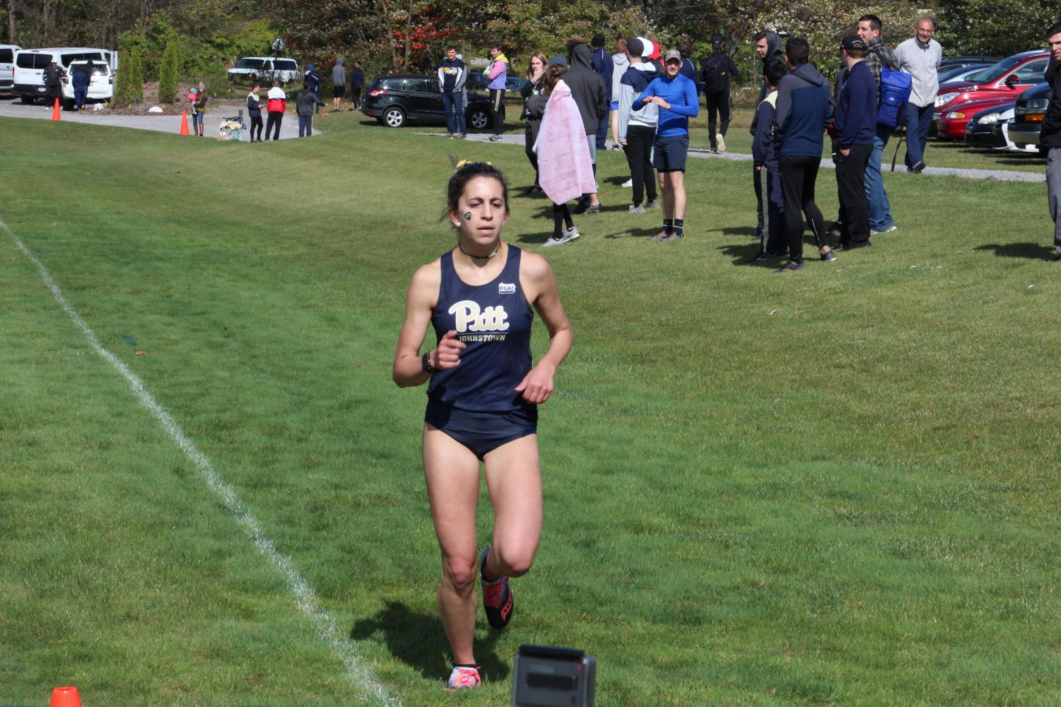 Pitt-Johnstown's women cross-country junior Samantha Kluz finished her four-mile run and led the women's cross-country team to second place Oct. 5 in the Pitt-Johnstown University invitational at the Pitt-Johnstown's cross-country trail.