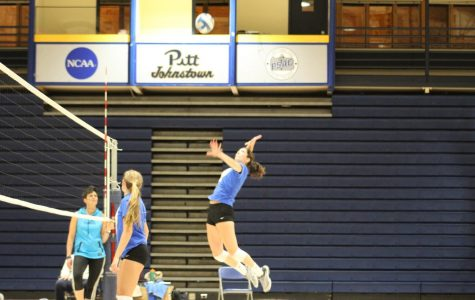 Sophomore Cassie Pascarella (right) tries to make a kill during practice Oct. 24 at the Pitt-Johnstown Sports Center.