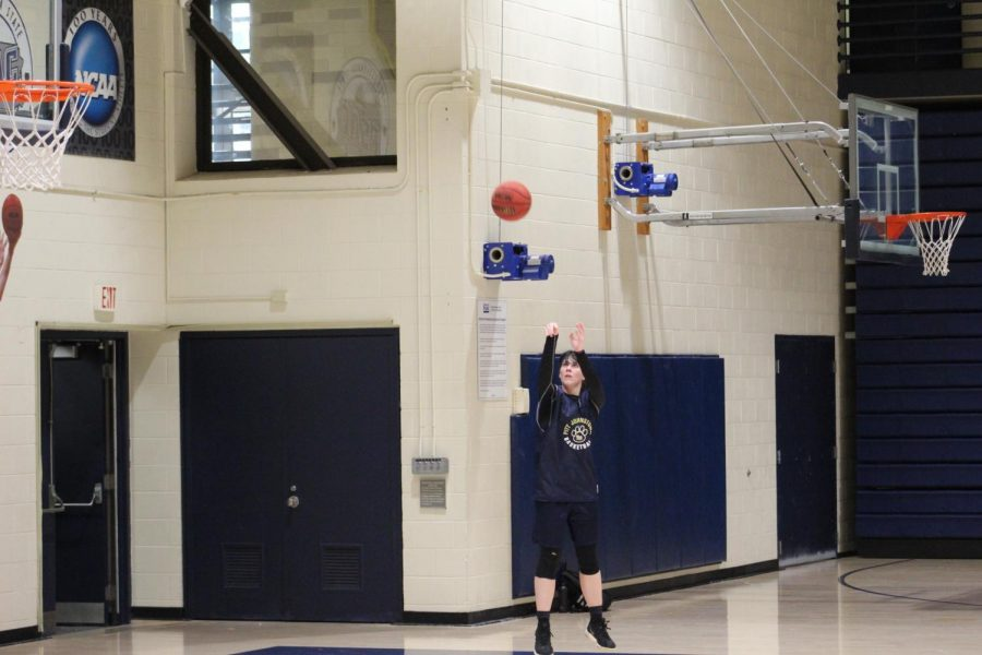 Senior Alli McGrath, the new women's basketball co-captain, practiced three-pointer shooting in the Pitt-Johnstown Sports Center.