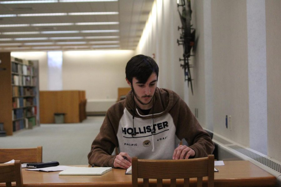 Sophomore Alex Markley studies thermodynamics for an exam the following day Sunday in the Library.