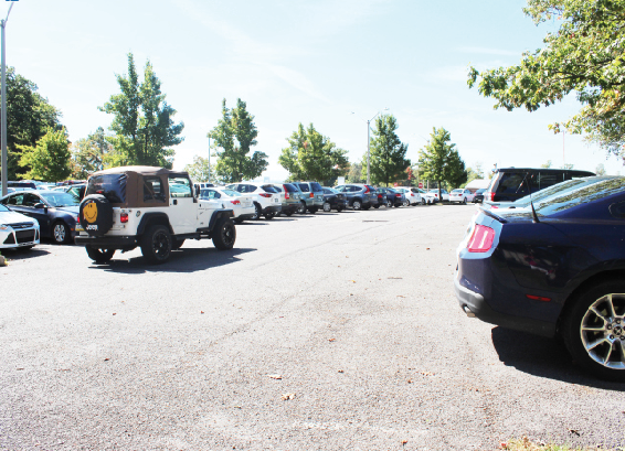 A student circles a crowded Biddle parking lot in search of a parking space.  Some students have been complaining that there is not enough parking spaces provided for the number of students on campus.