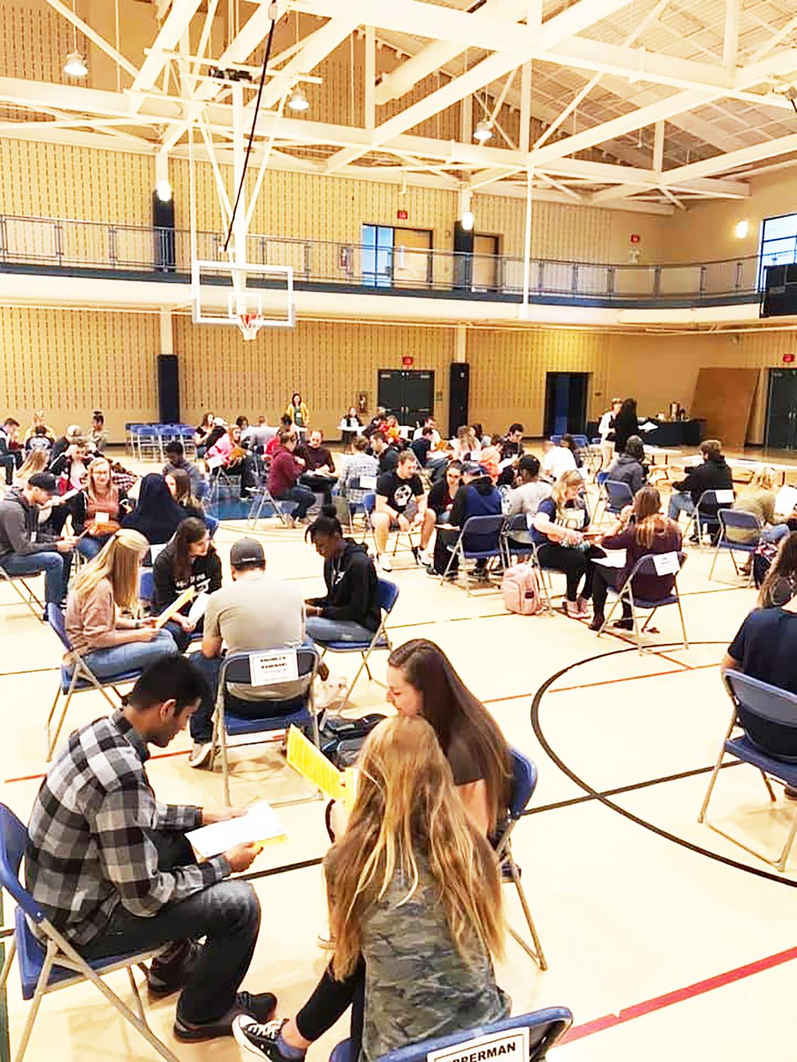 Students who participated in the poverty simulation were broken up into families with different circumstances Sept. 27