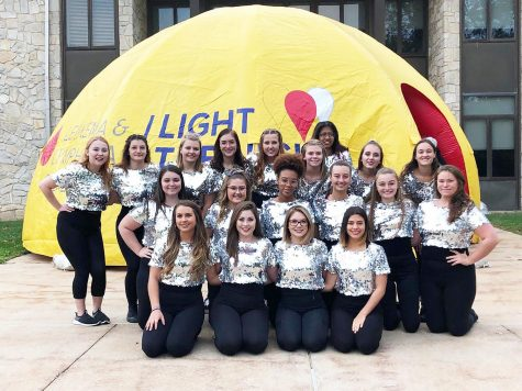 Dance Ensemble members posing before they performed at he Light the Night walk Oct. 5.