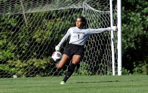 Senior goalie Maria Mosquera kicks the ball during a Nov. 8 women's soccer game against Edinboro Univeristy at the Pitt-Johnstown soccer field; Pitt-Johnstown won the game 4-3. |