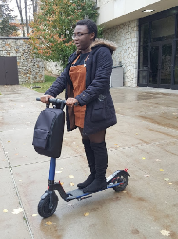 Sophomore Shunterra Davis rode her scooter in front of the Academic Success Center Thursday.