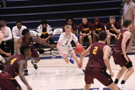 Sophomore Joe Batt was dribbles the ball in the Jan.6 game against Gannon University that Pitt-Johnstown won 82-81.