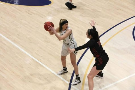 Freshman Makalyn Clapper was holding the ball and got 10 points against Mansfield University. Pitt-Johnstown won 84-59.
