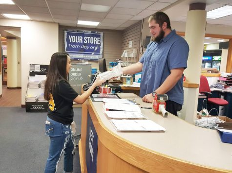 Book Center employee Sean Hitchens helped junior Lexi Weber complete a price match on Jan. 16 for her textbook purchase.