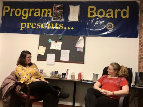 Program Board member Katelyn Zalduendo (left) and Program Board president Madison Clapsadle (right) talk in the Program Board office Thursday.  Clapsadle said she feels the friendly environment and enthusiasm that Program Board members offer is a reason why students join the club.