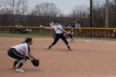 Pitt-Johnstown pitcher #18 Alyssa Hileman winds up to strike out the batter from Clarion.